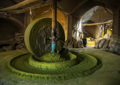Worker in a traditional henna mill, Yazd Province, Yazd, Iran