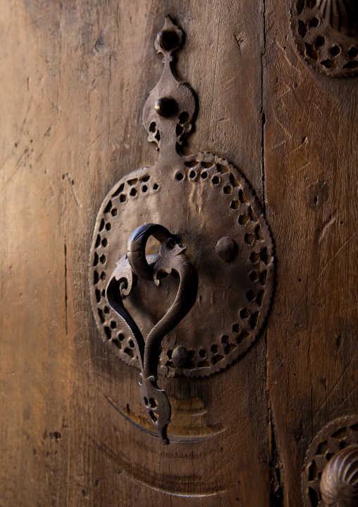 Ancient female doorknocker on a wooden door, Isfahan Province, Kashan, Iran