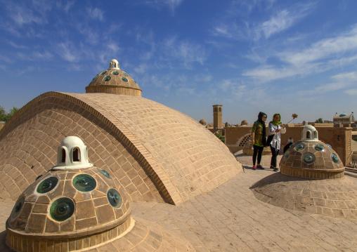 Chinese tourists taking selfie on sultan Amir ahmad bathhouse terrace, Isfahan Province, Kashan, Iran