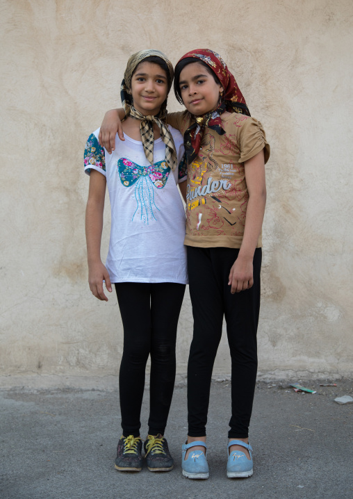 Two iranian girls with fashionnable clothes in the street, Lorestan Province, Khorramabad, Iran