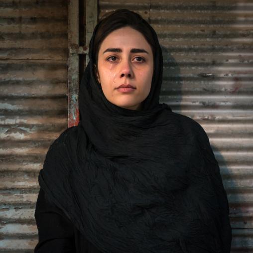Iranian shiite muslim woman crying during the Kharrah Mali ritual to mark the Ashura ceremony, Lorestan Province, Khorramabad, Iran
