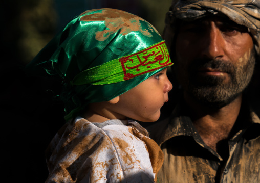 Iranian shiite muslim toddler dressed for Muharram with his father, Lorestan Province, Khorramabad, Iran