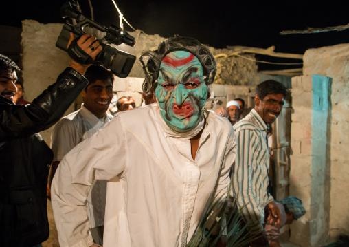 man wearing horror mask during a traditional wedding, Qeshm Island, Tabl , Iran