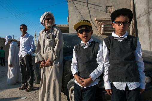 boys dressed in western way during a traditional iranian wedding, Qeshm Island, Salakh, Iran