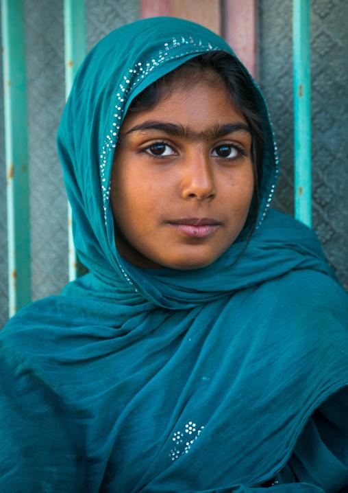 young veiled girl with big eyebrows, Qeshm Island, Salakh, Iran