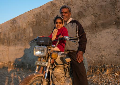 father and daughter on motorbike, Hormozgan, Kushkenar, Iran