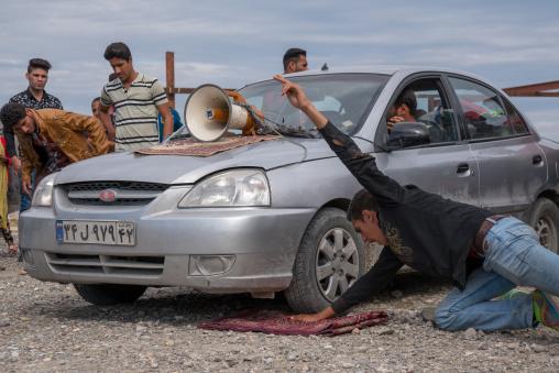 car rolling on the hand of a man, Hormozgan, Minab, Iran