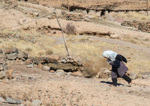 old widow woman in the troglodyte village, Kerman province, Meymand, Iran