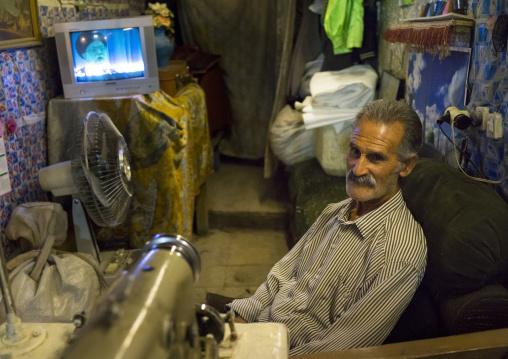 Man Watching Television In The Bazaar, Kermanshah, Iran