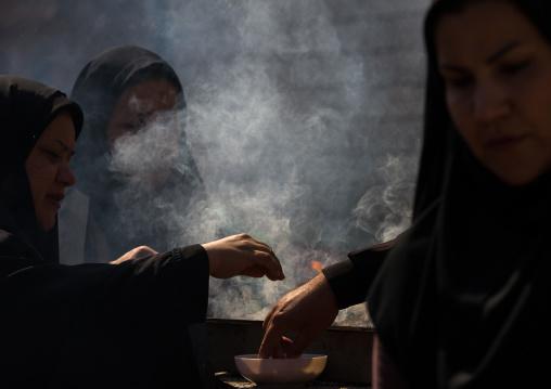 Shia Muslim Women Lighting Incense During Chehel Menbari Festival On Tasua Day For Ashura Celebration, Lorestan Province, Khorramabad, Iran