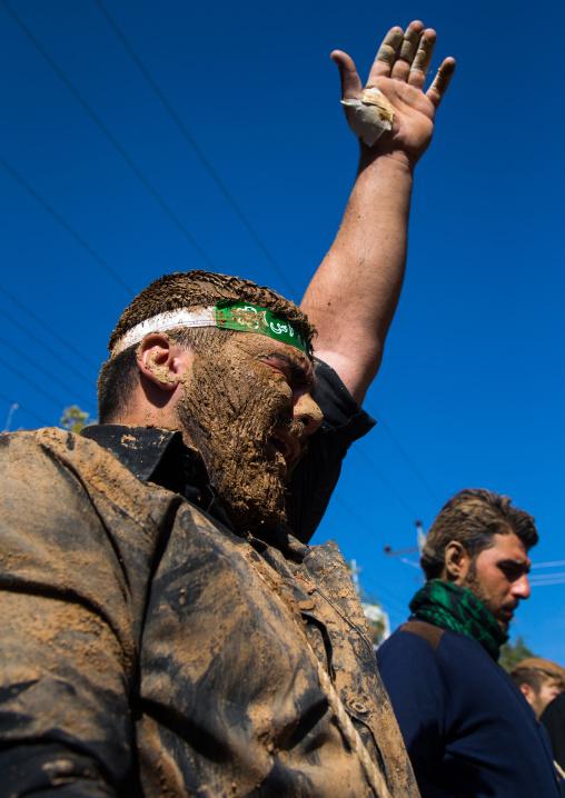Iranian Shiite Muslim Men Covered In Mud Crying During Ashura Day, Kurdistan Province, Bijar, Iran
