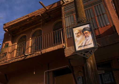 Khameini And Khomeini Poster In Front Of An Ancient Building In Zoroastrian Village, Isfahan Province, Abyaneh, Iran