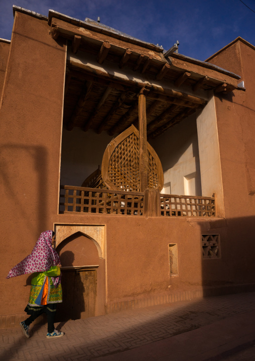 Woman Passing In Front Of A Nakhl In An Ancient Building In Zoroastrian Village, Isfahan Province, Abyaneh, Iran
