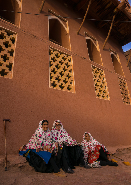 Portrait Of Iranian Women Wearing Traditional Floreal Chadors In Zoroastrian Village, Isfahan Province, Abyaneh, Iran
