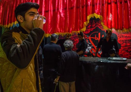 Iranian Shiite Muslim People Drinking Nazri Hot Milk Distributed Freely During Muharram, Isfahan Province, Kashan, Iran