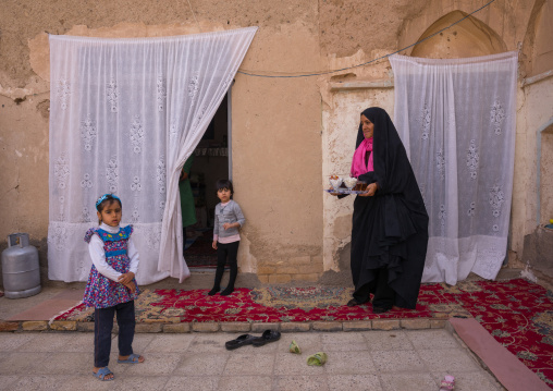 An Afghan Refugee Mother With Her Daughters In Their Home Courtyard, Isfahan Province, Kashan, Iran