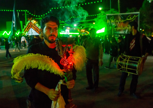 Iranian Shiite Muslim Man Holding An Incense Burner During Ashura, The Day Of The Death Of Imam Hussein, Isfahan Province, Kashan, Iran