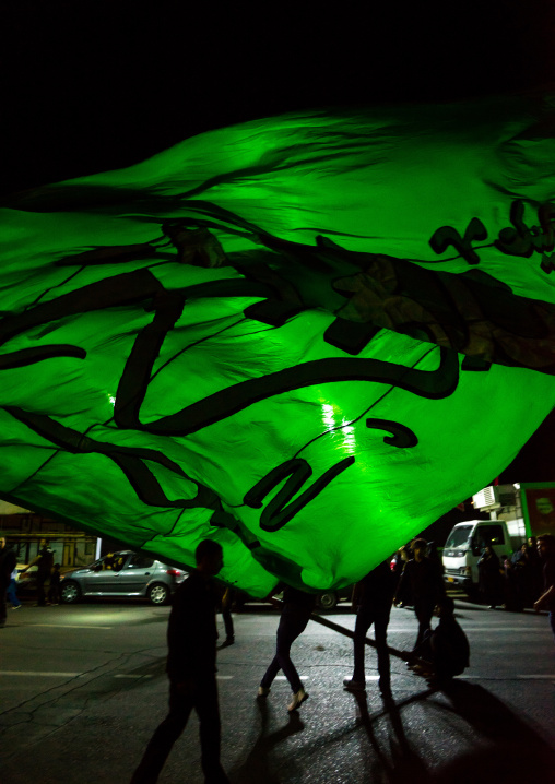 Iranian Shiite Muslims Men Parading With Green Flag During Ashura, The Day Of The Death Of Imam Hussein, Isfahan Province, Kashan, Iran