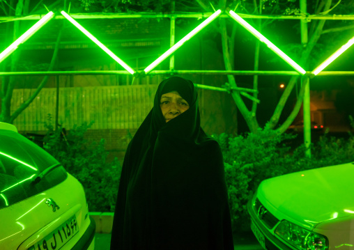 Iranian Shiite Muslim Woman In Green Light During Ashura, The Day Of The Death Of Imam Hussein, Isfahan Province, Kashan, Iran
