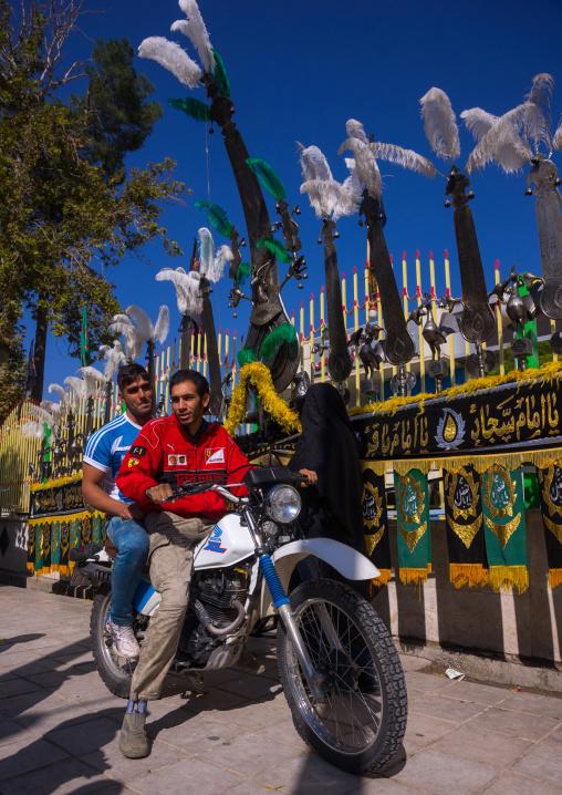 Iranian Men On Mototbike In Front Of An Alam On Tasua Celebration, Lorestan Province, Khorramabad, Iran