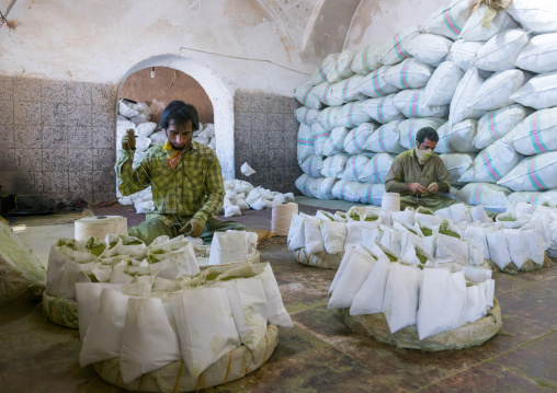 Men Packing Henna Bags In A Traditional Mill, Yazd Province, Yazd, Iran