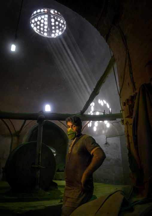 Worker With Green Dust On His Face In Traditional Henna Mill, Yazd Province, Yazd, Iran
