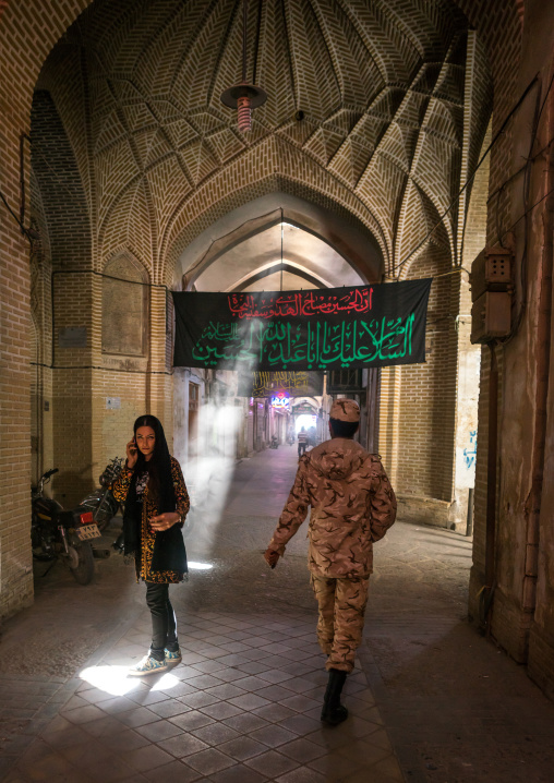 Woman And Soldier In An Empty Bazaar, Yazd Province, Yazd, Iran