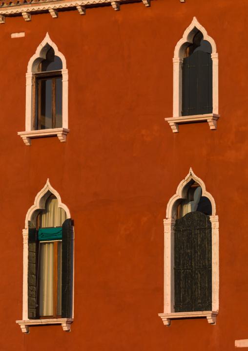 Venetian windows on a red historic house, Veneto Region, Venice, Italy
