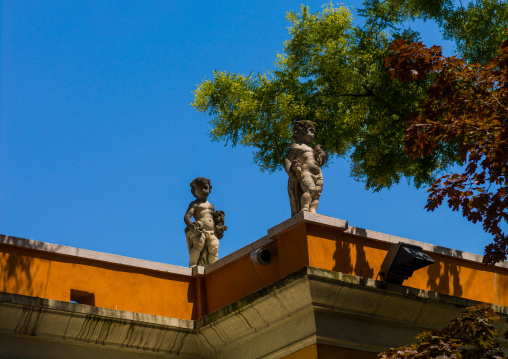 Statues on the top of an old house, Veneto Region, Venice, Italy