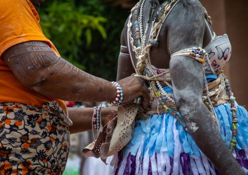Women dressing for a ceremony in Adjoua Messouma Komians initiation centre, Moyen-Comoé, Aniassue, Ivory Coast