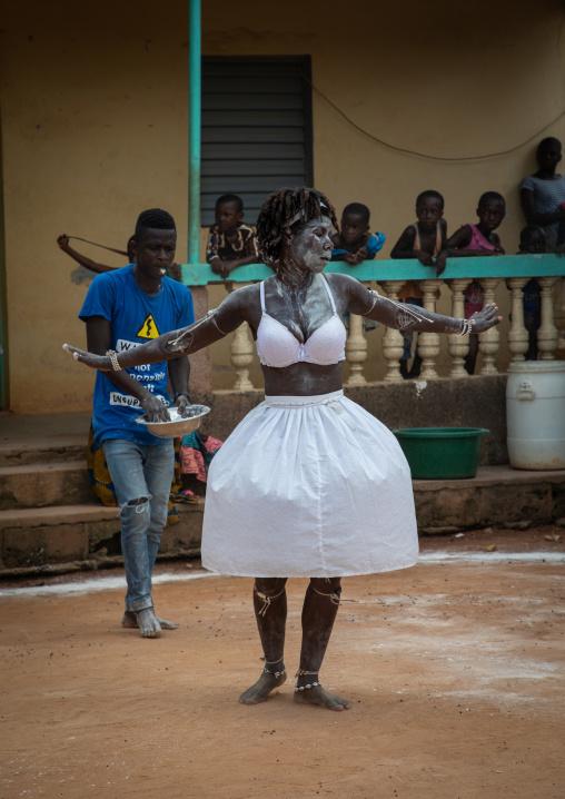 Komian woman dancing during a ceremony in Adjoua Messouma Komians initiation centre, Moyen-Comoé, Aniassue, Ivory Coast