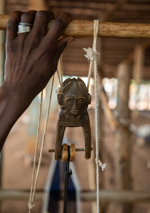 Figural heddle pulley in a traditional Senufo weaving factory, Savanes district, Waraniene, Ivory Coast