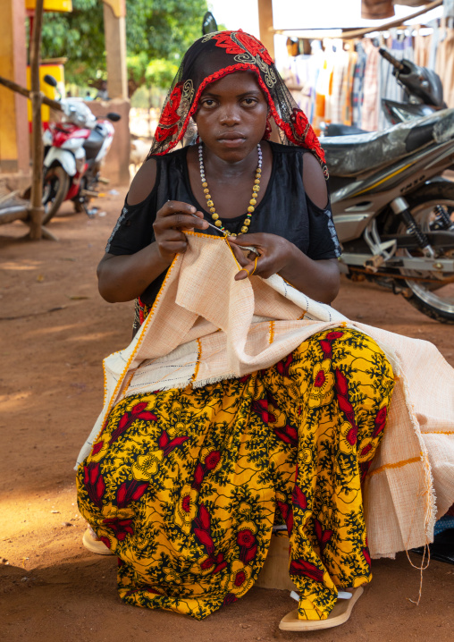 Senufo woman sewing in a market, Savanes district, Waraniene, Ivory Coast