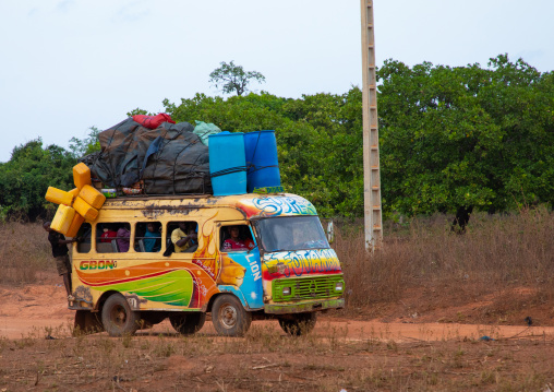Colorful painted local taxi bus in the countryside, Savanes district, Waraniene, Ivory Coast