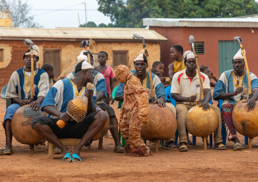 African musicians playing koras during Boloye dance of the panther man, Savanes district, Waraniene, Ivory Coast