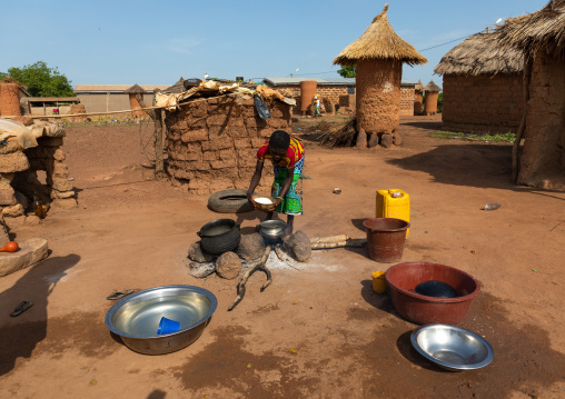 African woman preparing food in the house courtyard, Savanes district, Niofoin, Ivory Coast