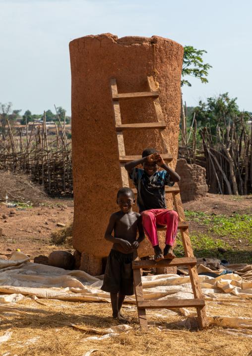 African children repairing a granary, Savanes district, Niofoin, Ivory Coast