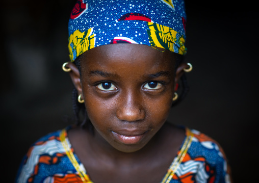 Portrait of a Peul tribe girl with colorful clothes, Savanes district, Boundiali, Ivory Coast