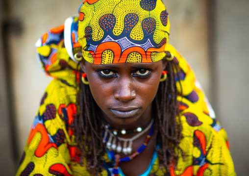 Portrait of a Peul tribe young woman with colorful clothes, Savanes district, Boundiali, Ivory Coast