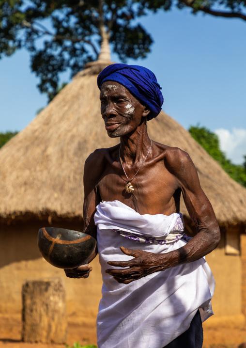 Dan tribe senior woman dancing during a ceremony, Bafing, Gboni, Ivory Coast