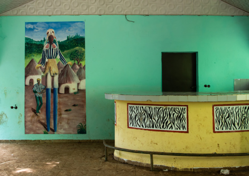 Empty bar decorated with a mural depitinf a Dan tribe masked dancer, Tonkpi Region, Man, Ivory Coast