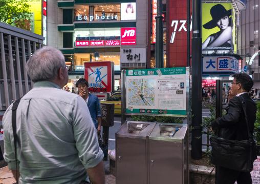 Men in a outdoors public smoking area in shibuya, Kanto region, Tokyo, Japan