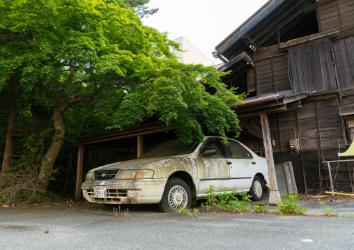 Abandoned car after the 2011 earthquake and tsunami five years after in the difficult-to-return zone, Fukushima prefecture, Tomioka, Japan
