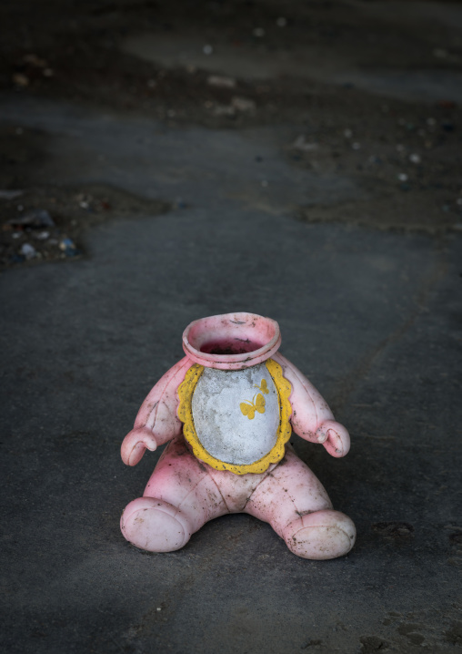 A doll without head inside a house destroyed by the 2011 earthquake and tsunami five years after, Fukushima prefecture, Namie, Japan
