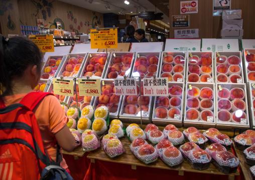 Peaches for sale in Kuromon ichiba market, Kansai region, Osaka, Japan