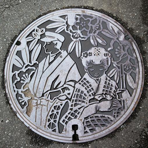 Manhole cover in the street, Izu peninsula, Izu, Japan