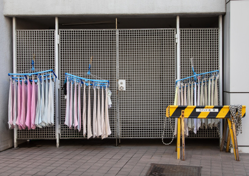 Clothes drying in the street, Kanto region, Tokyo, Japan