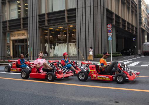 People driving karting cars dressed in super Mario, Kanto region, Tokyo, Japan