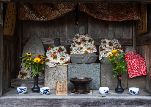 Stone statues in a shinto shrine, Kyoto Prefecture, Miyama, Japan