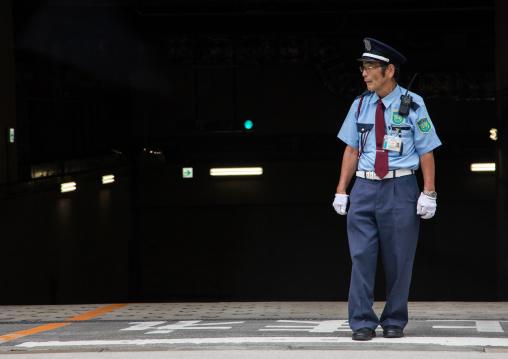 Senior japanese security guard in the street, Kansai region, Osaka, Japan